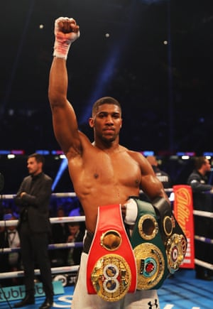 Anthony Joshua celebrates his victory and shows off his IBF, WBA & IBO Heavyweight Championship belts, which he retained.