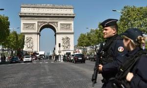 Police officers patrol the Champs Élysées in Paris