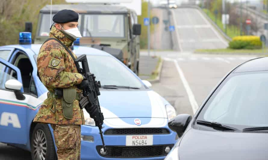 Italian soldiers and law enforcement officers carry out controls in Sesto San Giovanni, near Milan