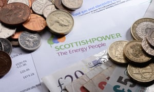 Scottish Power energy bill with coins and money.