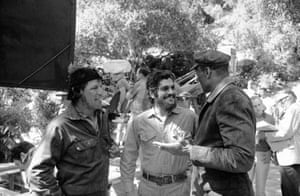 Playing the role of the Cuban revolutionary Ernesto (Che) Guevra, Sharif takes a break from filming in Hollywood with former Los Angeles policeman Rudy Diaz (left) and former football player Woody Strode, both of whom play the parts of members of Che's guerilla band, 1968
