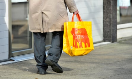 A shopper with a bag for life. Plastic bag use has plummeted by around 80% since the 5p charge was introduced.