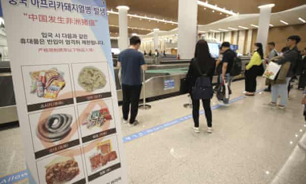 A signboard about African swine fever at Incheon international airport in South Korea.