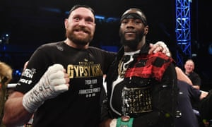 Tyson Fury poses with the WBC heavyweight champion Deontay Wilder after the Briton's defeat of Francesco Pianeta at Windsor Park.