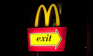 An exit sign at a McDonald's store