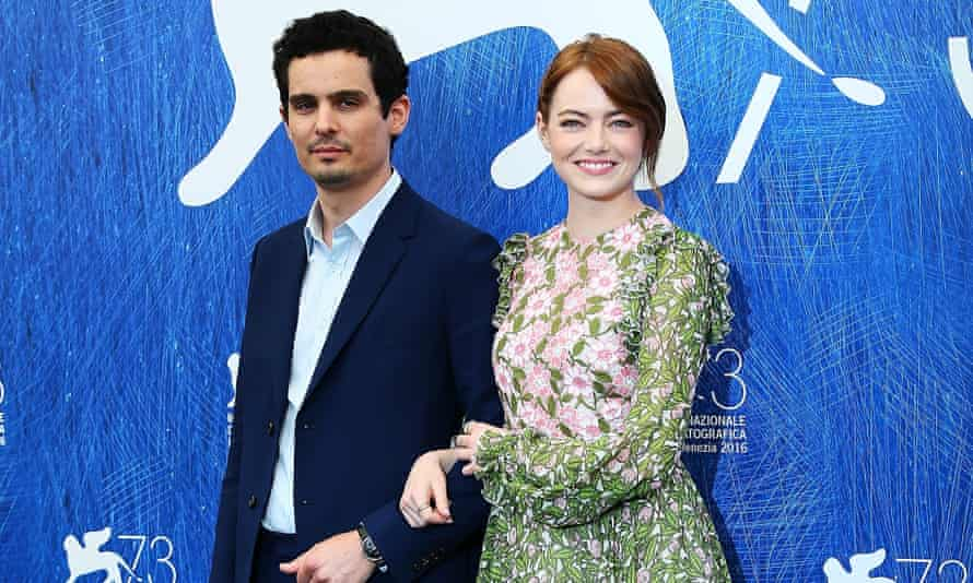 'The characters are cynical but the movie isn't' … director Damien Chazelle and Emma Stone promote La La Land at the Venice film festival.