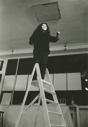 Yoko Ono preparing the interactive work Ceiling Painting for her first British exhibition at London's Indica Gallery in 1966.