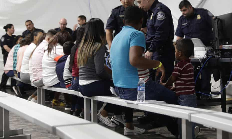 Migrants who are applying for asylum go through the processing area in Laredo, Texas, in September.