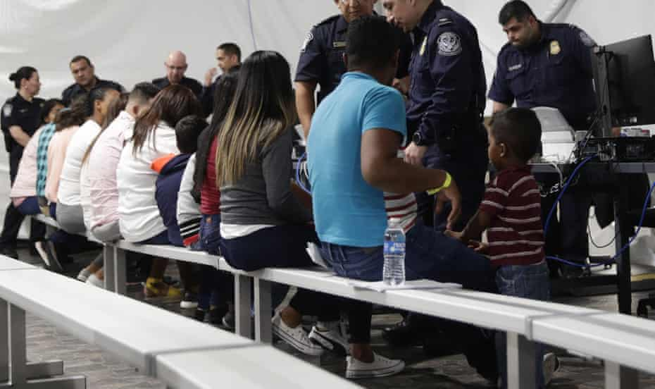 Migrants who are applying for asylum in the US go through a processing area in a new tent courtroom at a facility in Laredo, Texas.
