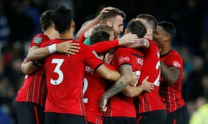 Southampton players congratulate goalkeeper Angus Gunn after his save from Theo Walcott sent them through to the last 16.
