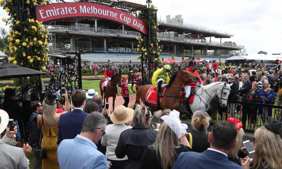 The horses head out on Melbourne Cup day at Flemington racecourse.