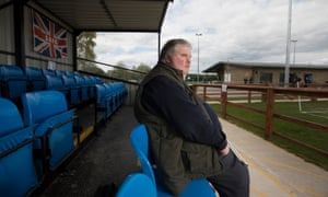 John Stancombe, here at Sandbach United, arranges with the clubs he visits for a volunteer to describe the stadium to him and for a commentator to talk him through the match.
