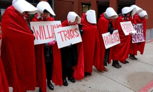 Planned Parenthood supporters dressed in The Handmaid's Tale costumes on Thursday in St Louis, Missouri.