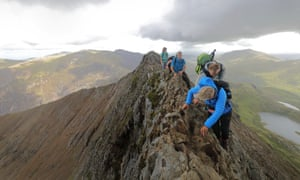 walkers tackling Snowdon's Crib Goch ridge.