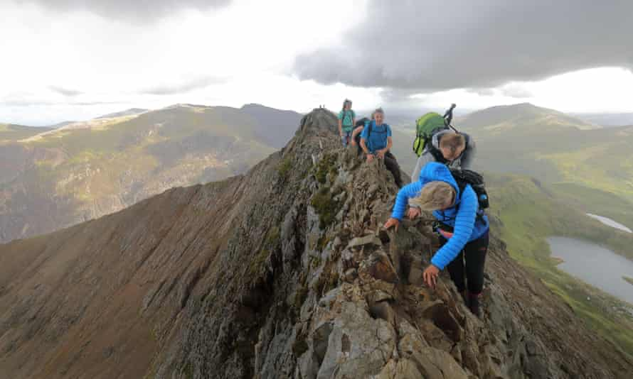 walkers tackling Snowdon's Crib Goch ridge.