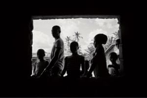 People standing at a window