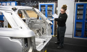 An apprentice works on the assembly line at the Jaguar Land Rover factory in Solihull.