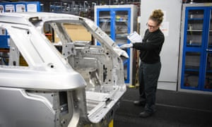A worker at the Jaguar Land Rover plant in Solihull, UK.