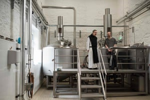 Father Joseph and Brother Mateusz oversee the brewing process