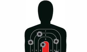 Indoor shooting range silhouette paper target shot full of bullet holes