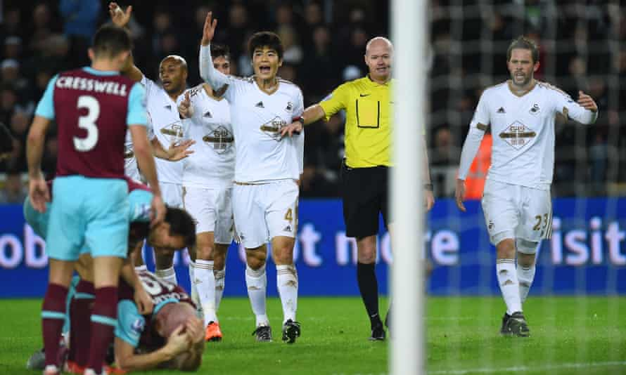 Swansea players appeal to referee Lee Mason
