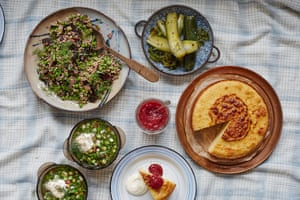 A Russian picnic of okroshka (a cold vegetable soup), buckwheat salad, pickled cucumbers and semolina cake.