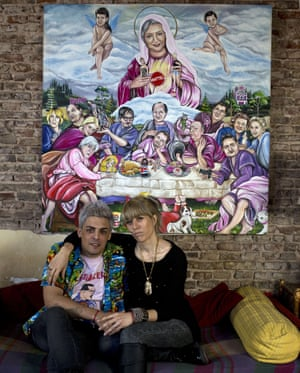 Emiliano Pool Paolini and Marianela Perelli with their painting of the Last Supper.