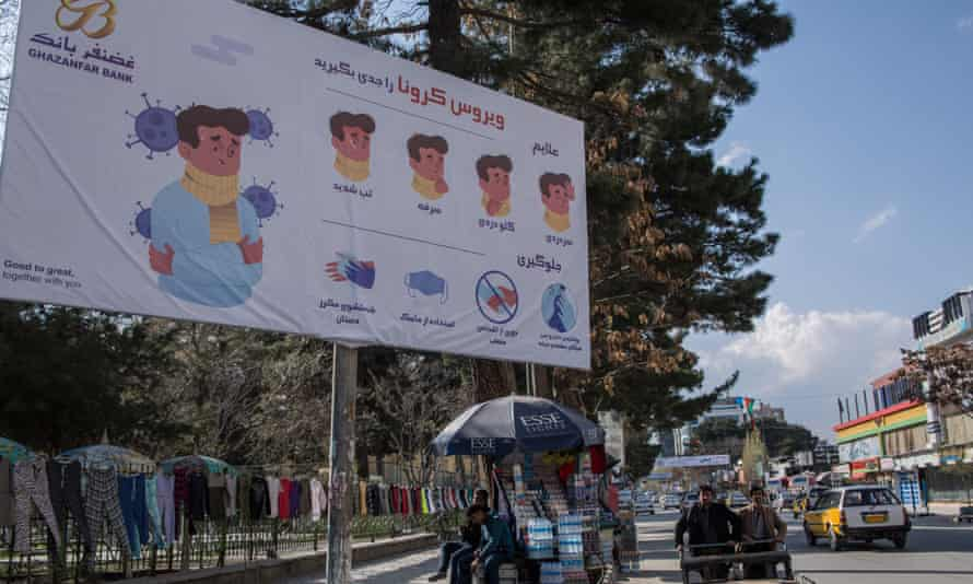 Signs warns of the risks of the coronavirus in Kabul