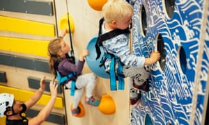 Children on the climbing wall at Adrenaline Indoors, Adventure Parc Snowdonia