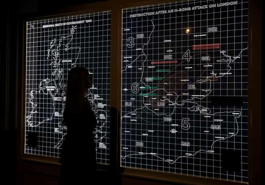 Cold War exhibitionA lady looks a map showing the destruction after an H-bomb attack on London.