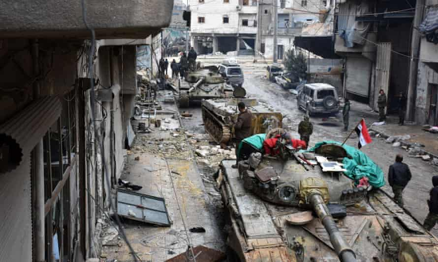 Pro-government forces patrol Aleppo on Wednesday.