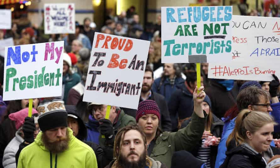 People rally to protest Donald Trump's travel ban on refugees and citizens of seven Muslim-majority nations.