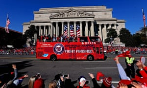 The Nationals parade moves past the National Archives on Constitution Avenue, near the National Mall.
