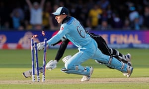 England's Jos Buttler runs out New Zealand's Martin Guptill during the super over to win the Cricket World Cup.