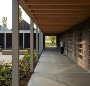 'A handsome facility a world away from the former makeshift barns' … retreat attendees on a walkway.