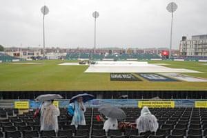 Pakistan fans as rain delays the start of play.