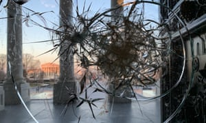 A window at the US Capitol building broken by supporters of US President Donald Trump.