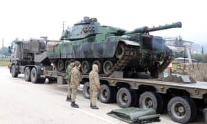 A Turkish tank is moved to the Syrian border in preparation for the attack.