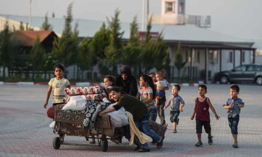 A Syrian family at the Boynuyogun refugee camp in Hatay, Turkey.