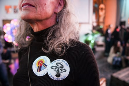 A supporter wears stickers backing an initiative that would decriminalize psilocybin mushrooms at an election watch party on 7 May.