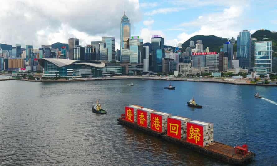 A ship carries the slogan 'celebrating the 23rd anniversary of Hong Kong's return to the motherland' in Victoria harbour, Hong Kong.