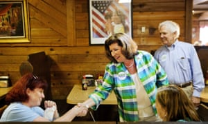 Karen Handel greets diners during a campaign stop at Old Hickory House in Tucker, Georgia Monday.