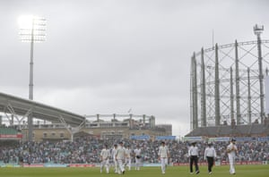 England Players leave the pitch as the rain starts.