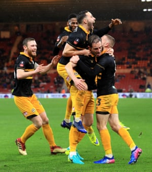 "Newport's Matthew Dolan celebrates with teammates after scoring the equaliser in the 93rd minute to earn a replay. Newport County manager Michael Flynn said after the match: ""I'm not soft but I do have a little bit of sentiment and I said to my assistant, look, we've got to give him (Dolan) a game because it's his home-town club."""