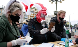 Activists wearing protective masks and gloves gather signatures in support of election candidates in Minsk