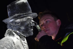 Icy stare? Sculptor Jack Hackney sizes up his creation, putting the finishing touches to a man's face
