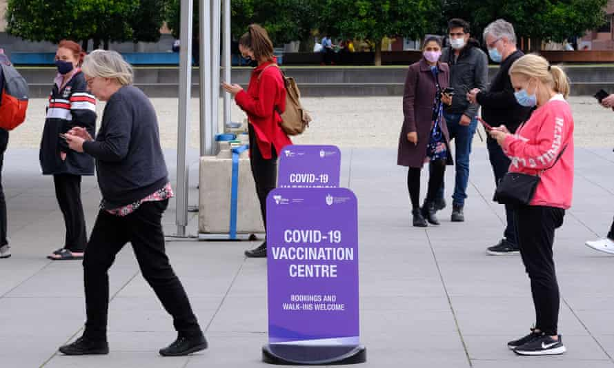 People line up to get vaccinated for Covid-19 outside the Royal Exhibition Building in Carlton, Melbourne.