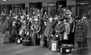 Children cheer as they leave London for Australia in 1932.