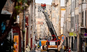 Rescue services inspect the neighbouring buildings of those that collapsed in Marseille in November 2018.