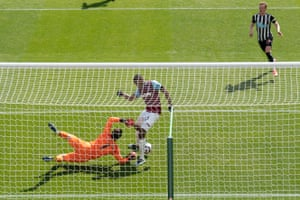 West Ham's Issa Diop centre tanges with goalkeeper Lukasz Fabianski as he scores an own goal.